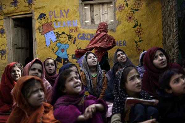 Pakistani schoolgirls, displaced with their families from the country's tribal areas because of fighting between militants and the army, attend school in a poor neighborhood on the outskirts of Islamabad. http://photos.thenews.com.pk/